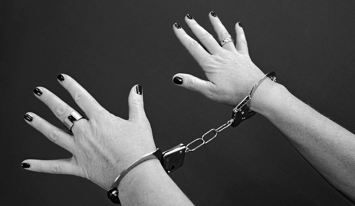 A woman's hands in handcuffs