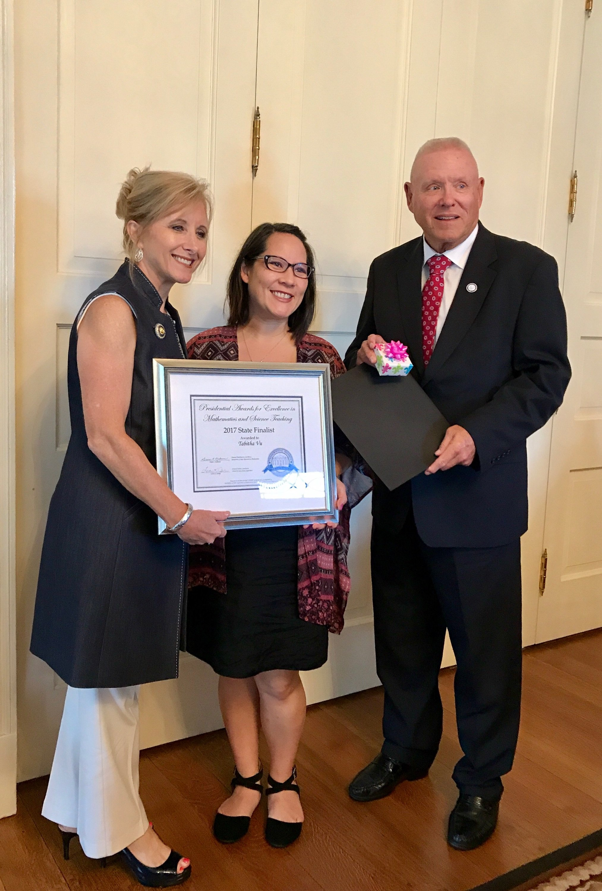 Vu receives certificate with LA first lady & BESE president