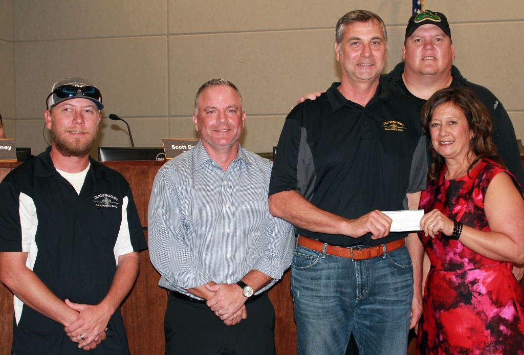 St Amant High officials receive sponsorship check