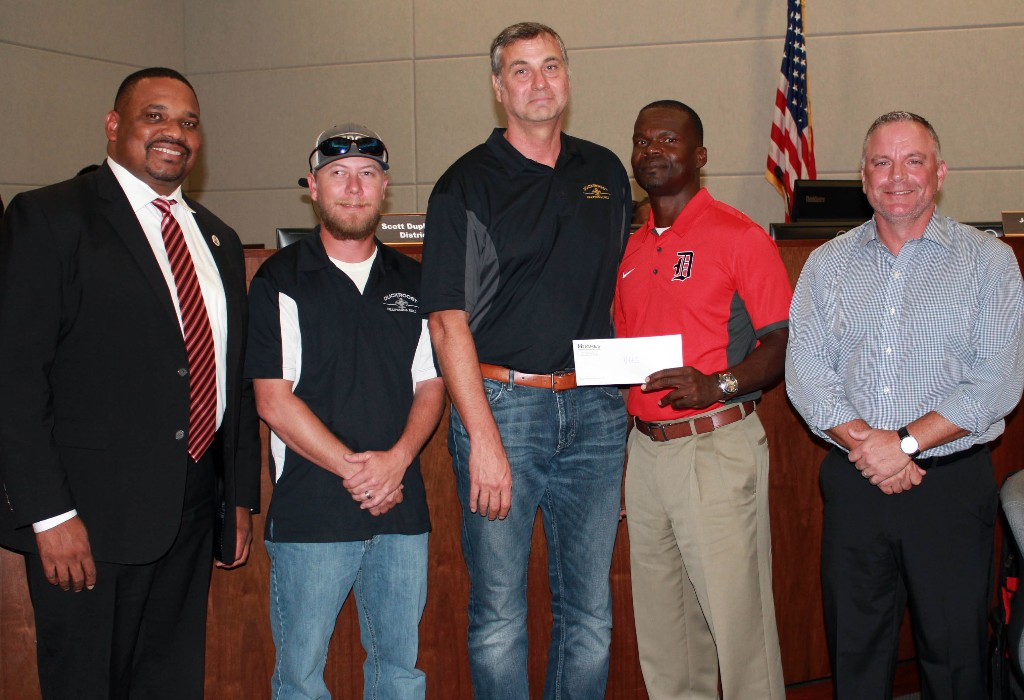 DHS representatives receive check from sponsors