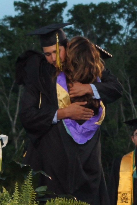 Mia hugs son Griffin during 2017 graduation