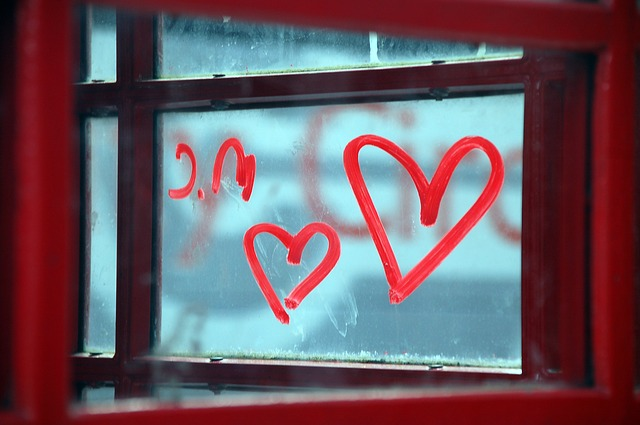 window with red hearts drawn on it