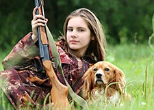 Hunter with her dog - public domain