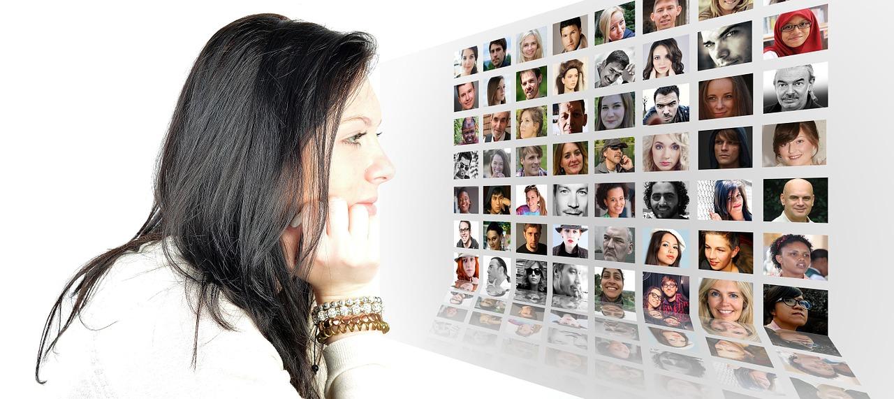Woman looking at digital photos