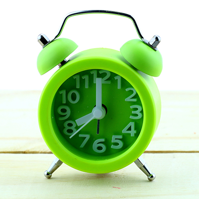 A green alarm clock
