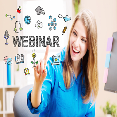 A woman pointing to the word 'webinar' illustrated along with some other illustrations