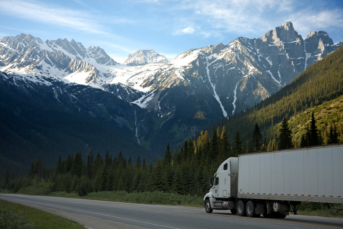 Photograph of a truck in the mountains