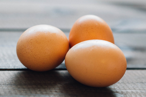 Photograph of eggs on a table.