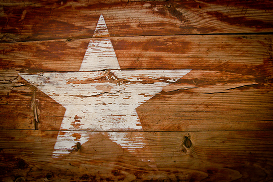 Photograph of the Star of Texas on wood.