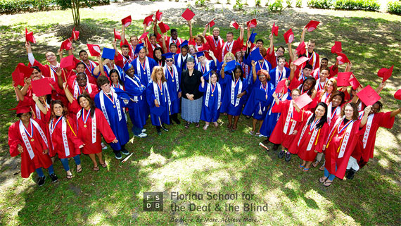 Aerial view of several students in red or blue graduation gowns, holding up their caps. Text: Florida School for the Deaf and the Blind.