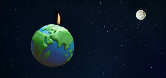 A wax model of Earth floats in space, with a burning candle wick on top.