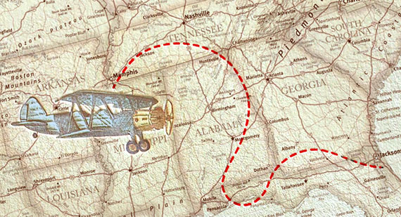 Map with a biplane flying above it with red dotted line showing path.