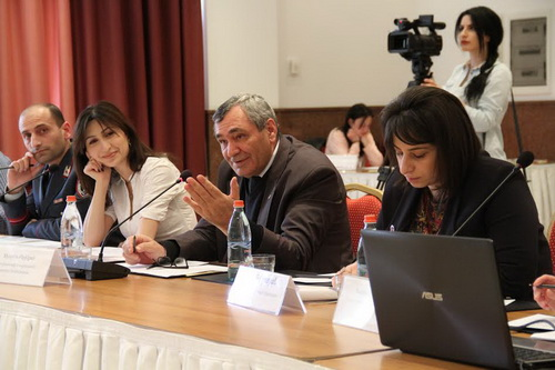 WSC Lawyer Nona Galstyan (right) stresses the vital role of domestic violence legislation alongside RA Deputy Minister of Labor and Social Affairs Filaret Berikyan (center).