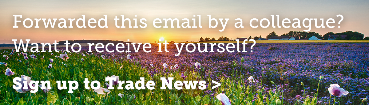 A bright sunset over a crop field of flowers with a call to action to sign up to Trade News