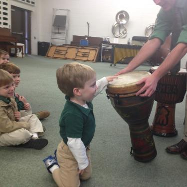 Boy playing djembe