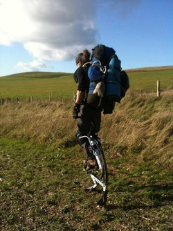 Paul walks across the countryside on his stilts!