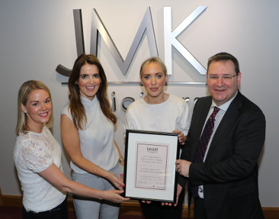 Pictured (l-r): Michele McGahan, Quality Compliance Manager; Maurece Hutchinson, Managing Director; Olivia Meehan, Legal Services Director; and Jonathan McKeown, Chairman at JMK Solicitors