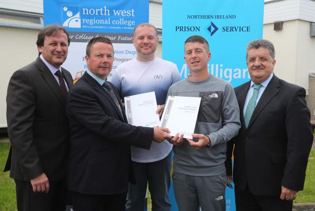 Pictured: Magilligan Prison Governor Richard Taylor presents certificates for education and training skills to prisoners