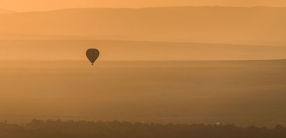 Hot air balloon floating over the Mara