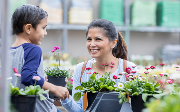 Image of a son and mother at a nursery getting plants