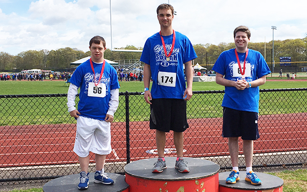 image of athletes on the podium during a Special Olympics event