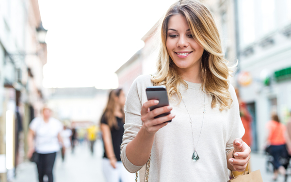 Image of a young woman banking on her smart phone