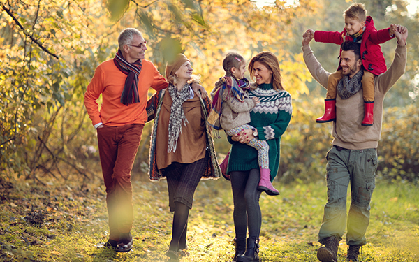 image of family in a park in the fall