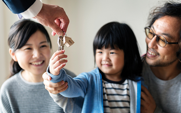 Image of family with keys to a new house