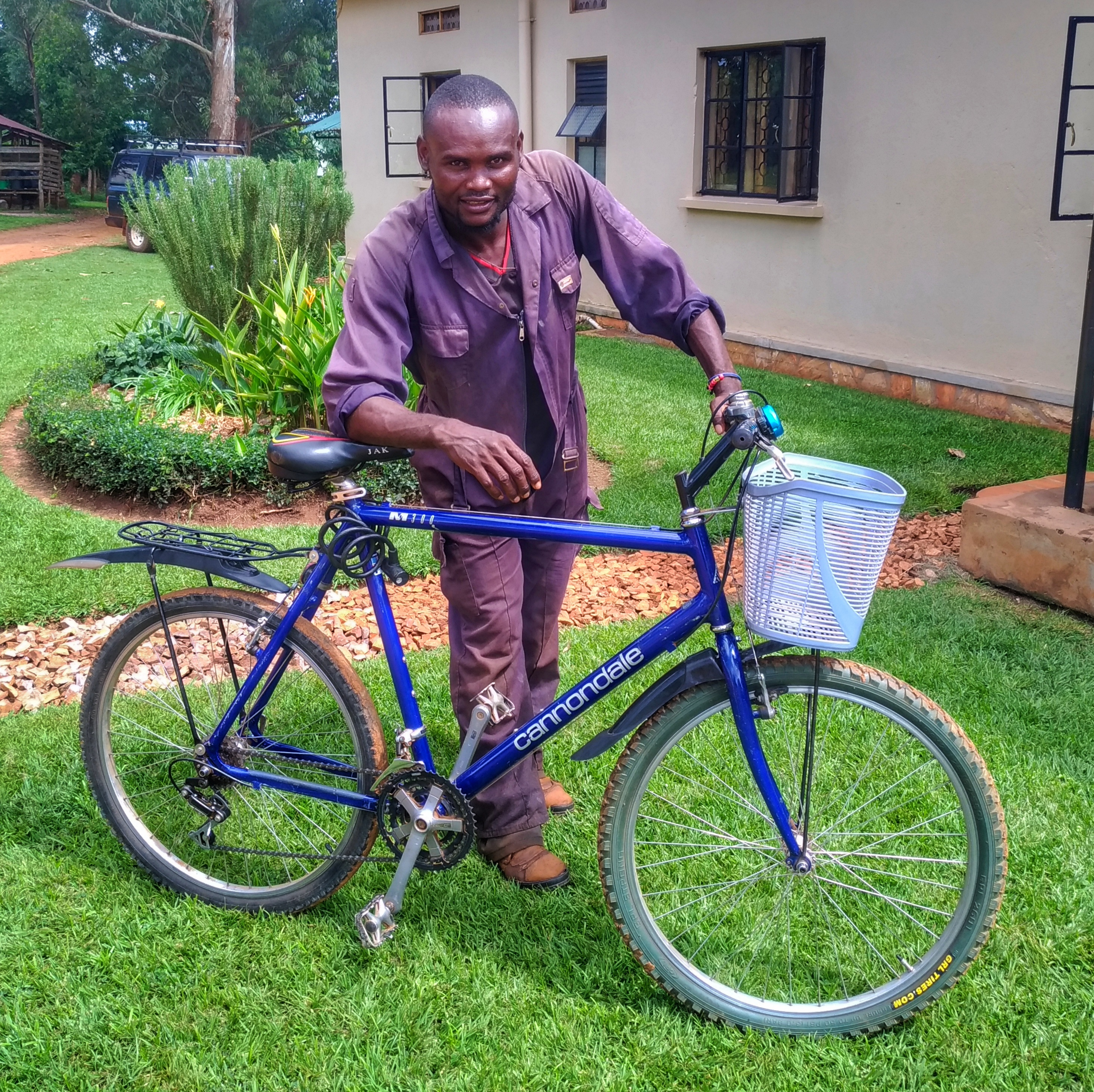 Ali and the bike he uses to visit audio Bible listening groups