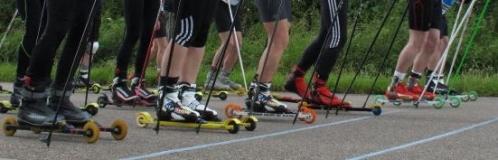Roller skiers on start line