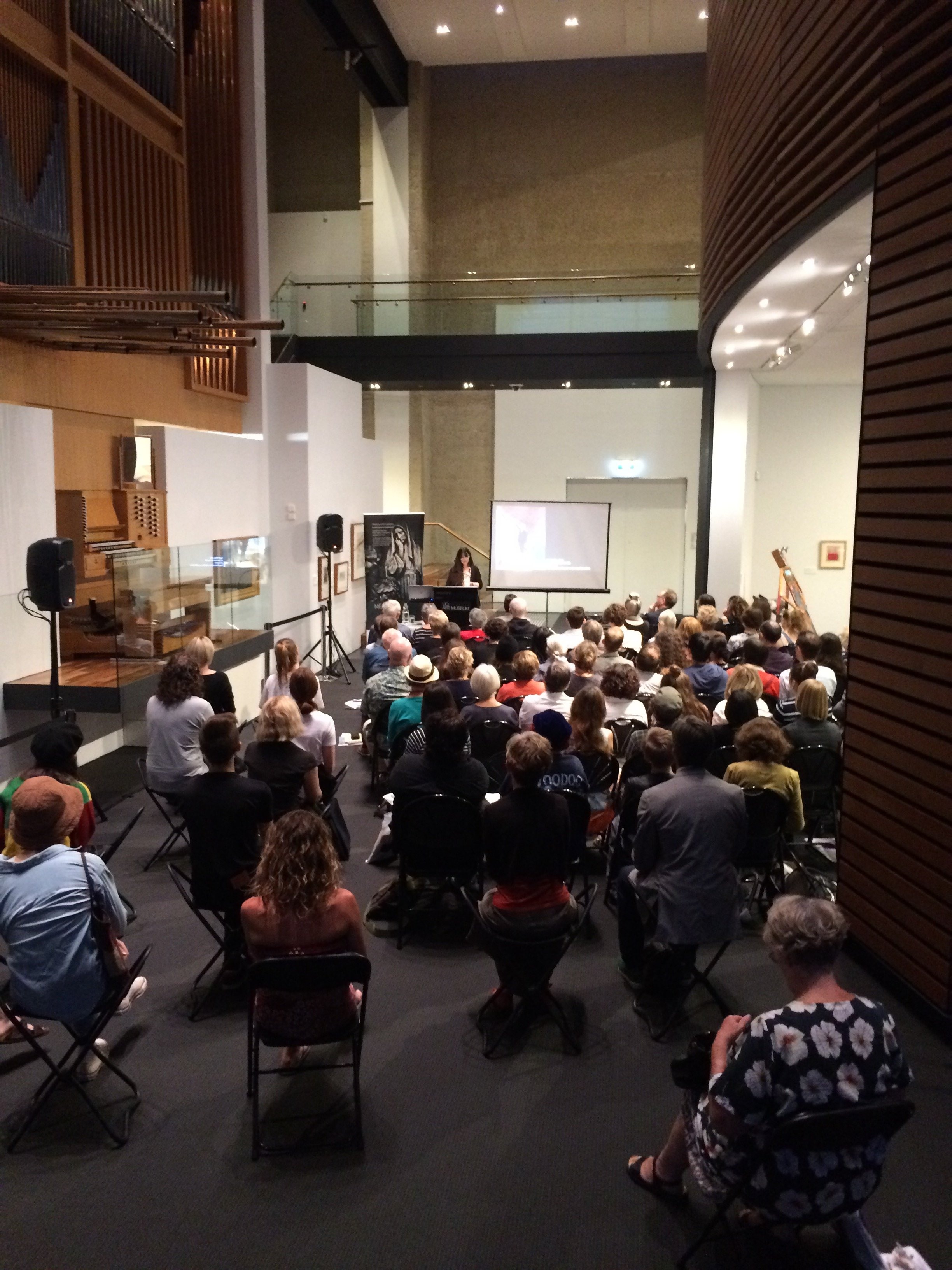 Angela Hesson delivering a lecture at the UQ Art Museum