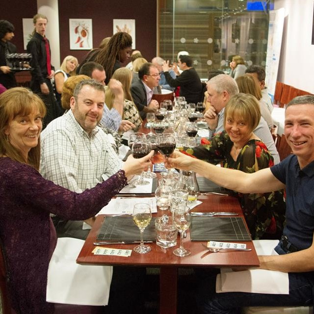 Guests enjoy dinner at The Restaruant West Herts College
