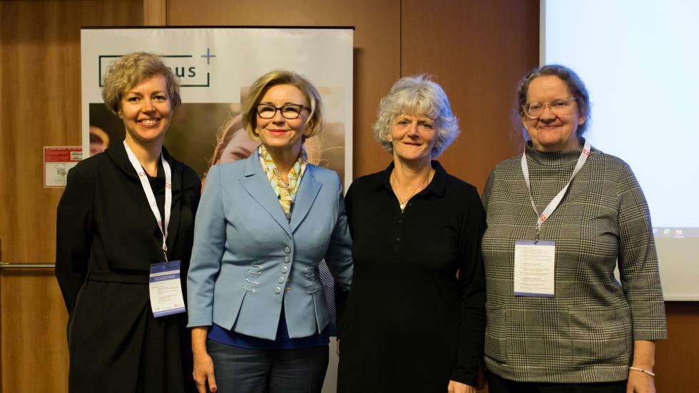 Agency staff posing with Ms Machalek of the Polish Ministry of National Education