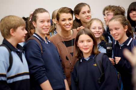 Ruby Rose with students