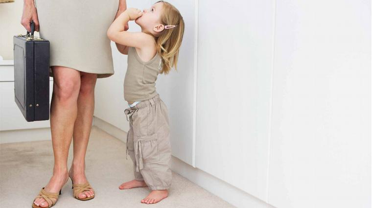 Little girl tugging at mother's skirt as she goes to work
