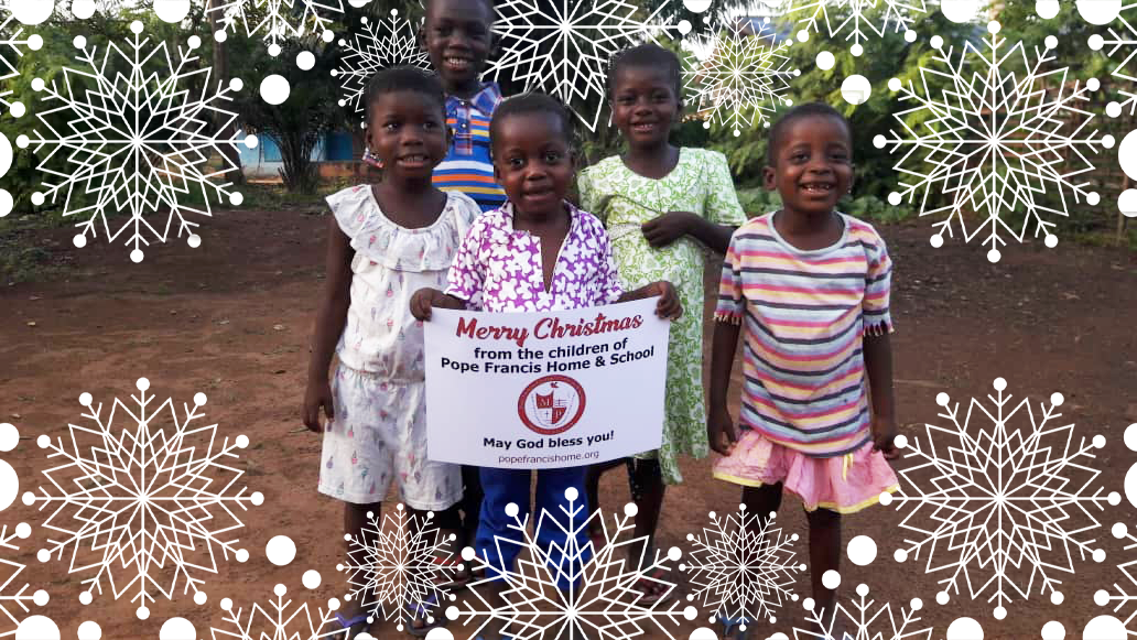 """Ghanian Children holding a sign """"Merry Christmas from the Children of Pope Francis Home & School May God bless you."""""""
