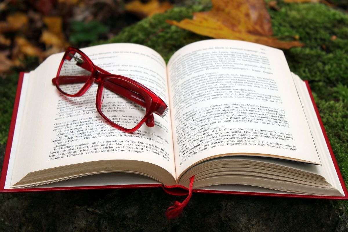 Open book with glasses on top