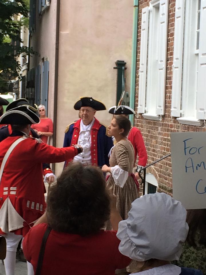 Mrs. Heyward protests her husband's arrest