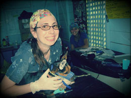 Andria holding a canine patient in Central America.