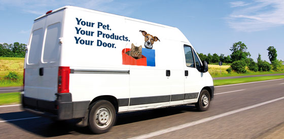 A delivery truck with Your Pet, Your Products, Your Door on the side of it.