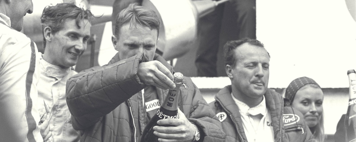 Dan Gurney prepares a surprise for the audience that would go on to unexpectedly start a tradition. Photo Courtesy of Dyler.com