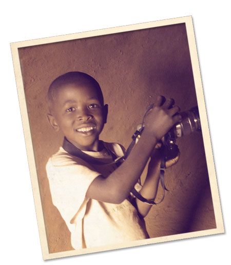 boy with photo camera in lesotho