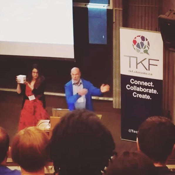 Photo of TKF alum, Tamara and TJ, handing out prizes during closing remarks