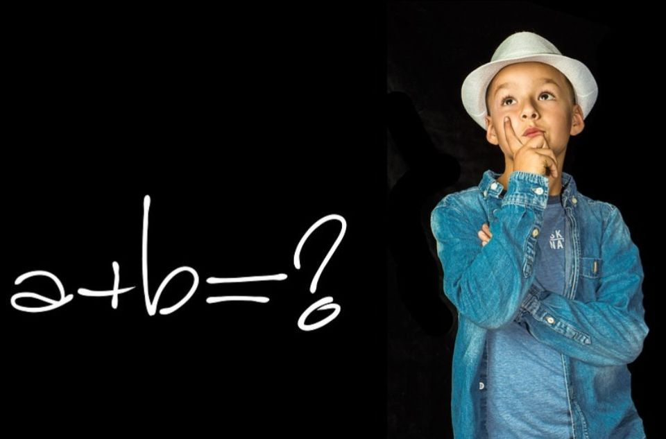 Boy thinking about maths (a+b=?)