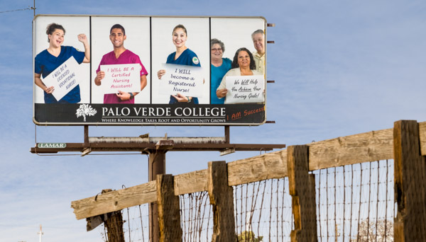 Billboard with college students