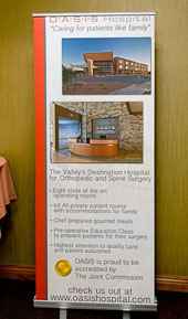 OASIS Hospital display sign with Laird Brown photographs