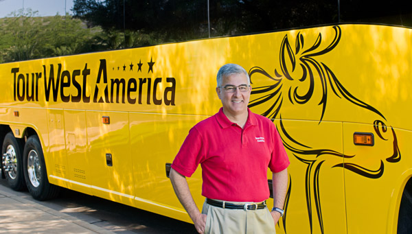 Peter Shelbo in front of TourWest America bus