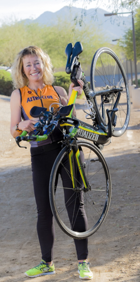Full length of Nancy Kummen with bicycle