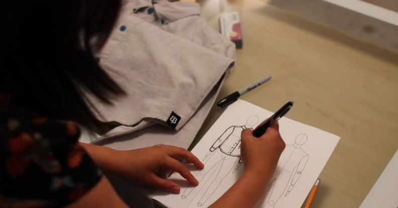Designer drawing a flat sketch