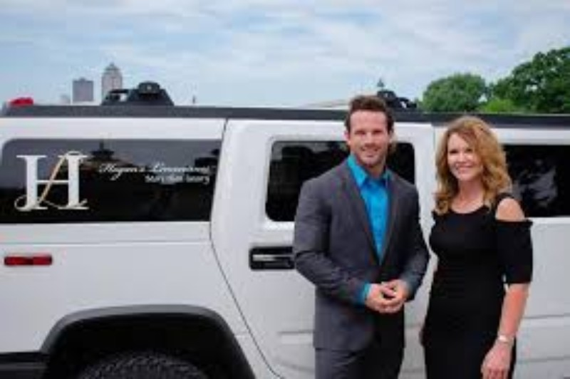 Joe and Tracy standing in front of a Hogan's Limo